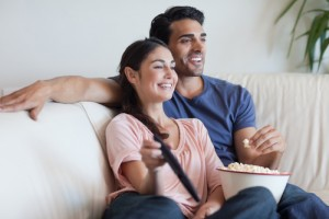 couple watching tv eating